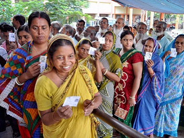 Voters stand in a queue to cast votes at a polling station during 3rd phase of state assembly elections in Murshidabad on Thursday. PTI