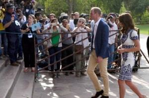 Onlookers click pictures as Britain's Prince William, along with his wife, Kate, the Duchess of Cambridge, enter the Taj Mahal in Agra on Saturday. PTI