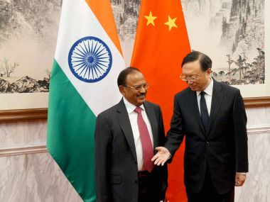NSA Ajit Doval with his Chinese counterpart Yang Diechi in Beijing on Wednesday. PTI