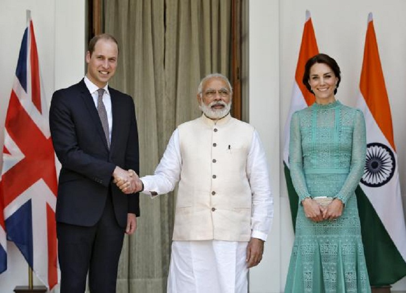Britain's Prince William shakes hands with India's Prime Minister Narendra Modi (C) as Catherine, Duchess of Cambridge, smiles during a photo opportunity at Hyderabad House in New Delhi, India, April 12, 2016. REUTERS/Altaf Hussain