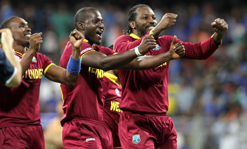 Dwayne Bravo, Darren Sammy and Chris Gayle celebrate after West Indies beat India by 7 wickets in the semi-final. Solaris Images