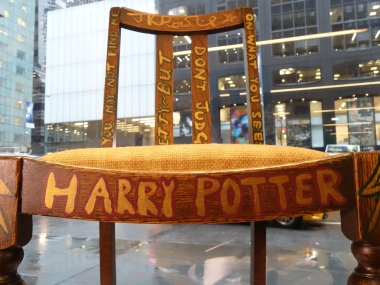 A chair used, and later decorated, by author JK Rowling while she wrote the first two Harry Potter books on display alongside a letter of provenance from the author at Heritage Auctions in New York. AFP