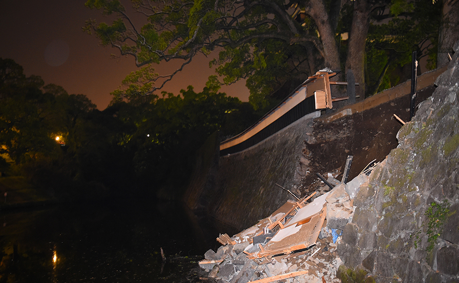 The stone wall of the Kumamoto Castle is seen partly collapsed on April 14, 2016 in Kumamoto, Japan. A powerful earthquake with a preliminary magnitude of 6.4 struck Kumamoto Prefecture on April 14, 2016. Getty