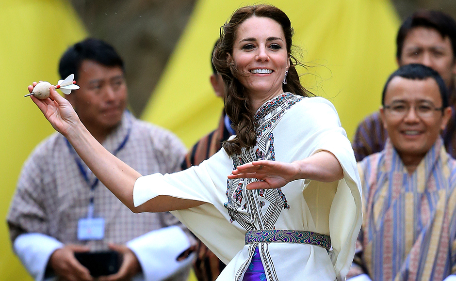 Catherine, Duchess of Cambridge throws a dart during a Bhutanese sporting demonstration on the first day of a two day visit to Bhutan on the 14th April 2016 in Paro, Bhutan. The Royal couple are visiting Bhutan as part of a week long visit to India and Bhutan that has taken in cities such as Mumbai, Delhi, Kaziranga, Bhutan and Agra. Getty