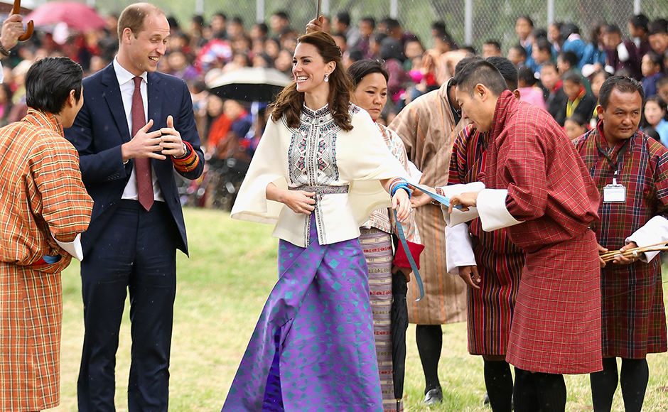 Prince William, Duke of Cambridge looks on as Catherine, Duchess of Cambridge fires an arrow during an Bhutanese archery demonstration on the first day of a two day visit to Bhutan on the 14th April 2016 in Paro, Bhutan. The Royal couple are visiting Bhutan as part of a week long visit to India and Bhutan that has taken in cities such as Mumbai, Delhi, Kaziranga, Bhutan and Agra. Getty