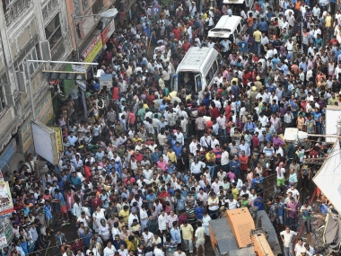 Ambulances stuck as people in large numbers gather at the site of the accident where an under-construction flyover collapsed on Vivekananda Road in Kolkata on Thursday. PTI