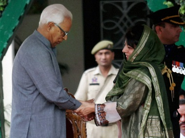 Jammu and Kashmir Governor NN Vohra administers the oath to Chief Minister Mehbooba Mufti, at Raj Bhawan in Jammu on Monday. PTI