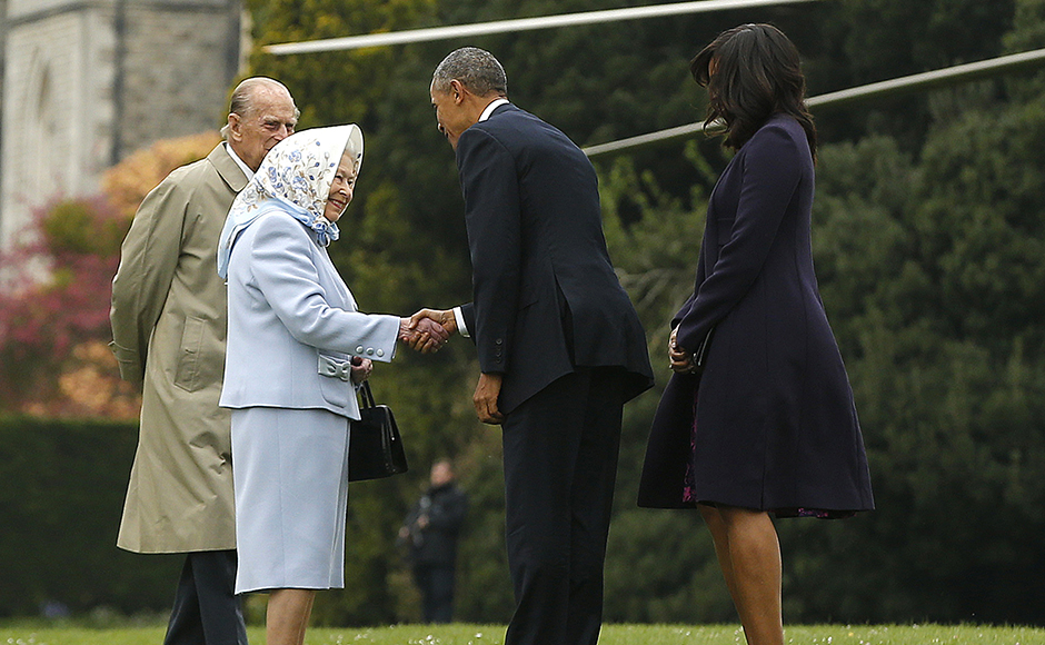 President Barack Obama and his wife first lady Michelle Obama are greeted by Britain's Queen Elizabeth II and Prince Philip after landing by helicopter at Windsor Castle for a private lunch in Windsor, Britain, Friday, April, 22, 2016. REUTERS/Alastair Grant/Pool