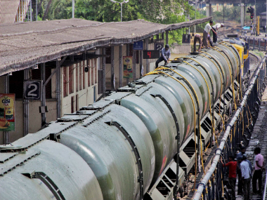Workers fill water in Central Railway train tanks to transport to drought affected Latur District from Miraj station near Sangli on Sunday. PTI