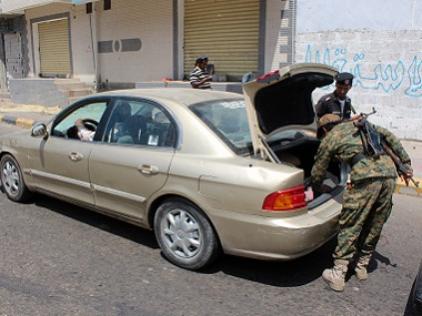 Yemeni loyalist forces inspect a car at a checkpoint on a road in Aden's Tawahi neighbourhood on Monday. AFP