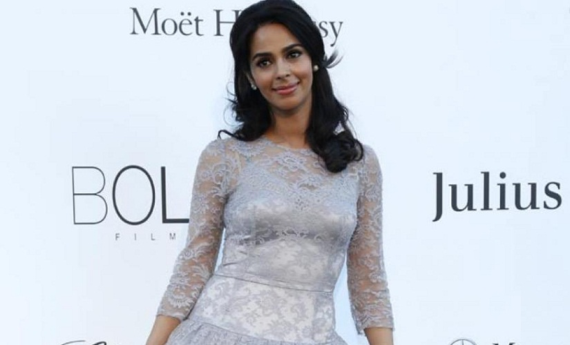 In a conservative Dolce and Gabbana lace dress in 2013