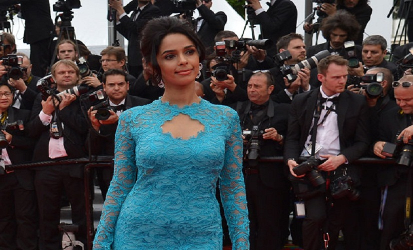 The blue lace gown she donned in 2014 didn't do Mallika any favours