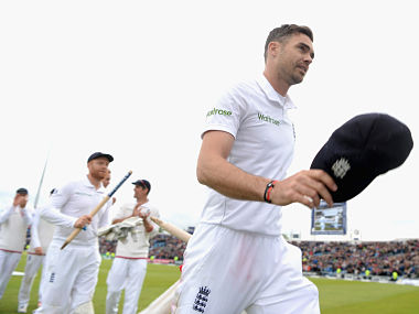 James Anderson salutes the crowd as he leaves the field after taking a ten wicket haul. Getty