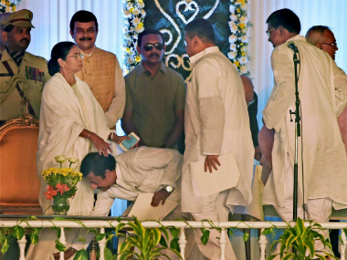 Bengal portfolios: Mamata keeps home, retains Mitra as finance minister