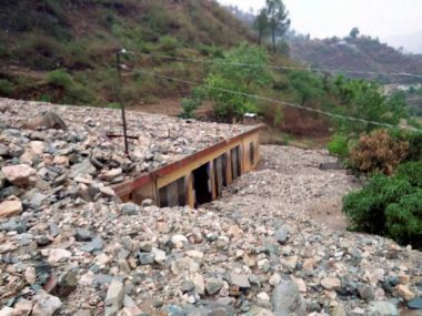 Houses buried under rubble after a cloudburst at Ghansali in Sialkot, Tehri on Saturday. PTI