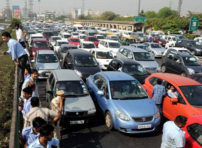 The mayhem continues: Delhi taxi drivers bring traffic to a screeching halt