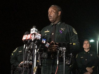 Orange County Sheriff Jerry Demings speaks at a news conference about the 2-year-old boy who was dragged into the water by an alligator. AP.
