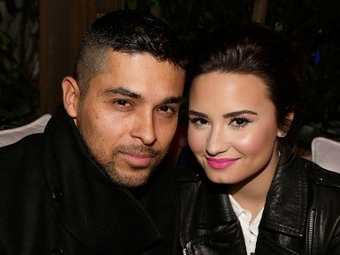 LOS ANGELES, CA - FEBRUARY 13:  Actor Wilmer Valderrama (L) and singer Demi Lovato wearing Topshop attend the Topshop Topman LA Opening Party at Cecconi's West Hollywood on February 13, 2013 in Los Angeles, California.  (Photo by Jeff Vespa/Getty Images for Topshop Topman)