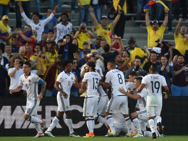 Colombia players celebrate a goal against Paraguay in their 2-1 win in Copa America Centenario. AFP