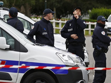 Police man a roadblock at the scene where a French police commander was stabbed to death in front of his home in the Paris suburb of Magnanville, France. Reuters