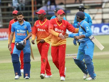Zimbabwe and Indian players shake hands after the second ODI. PTI