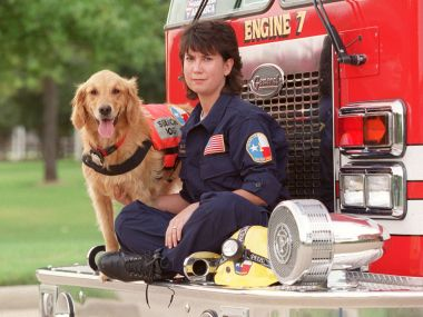 K9 Search Specialist Denise Corliss and her search dog Bretagne in Houston, Texas. AP