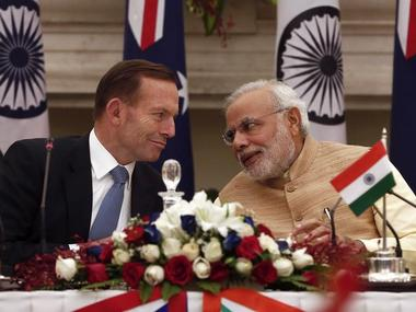 Australia's Prime Minister Tony Abbott (L) with his PM Modi during the signing of agreements ceremony in New Delhi. File Photo. Reuters