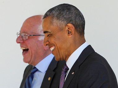 Democratic presidential candidate Bernie Sanders (L) walks with US President Barack Obama to the Oval Office at the White House in Washington, DC. Reuters