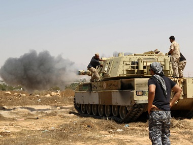 Forces loyal to Libya's UN-backed unity government fire from a tank in Sirte's centre towards Ouagadougou as they advance to recapture the city from the Islamic State. AFP