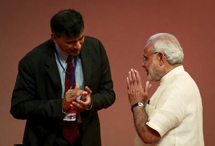 Prime Minister Narendra Modi gestures to Reserve Bank of India (RBI) Governor Raghuram Rajan at an event on financial inclusion in Mumbai April 2, 2015. REUTERS/Danish Siddiqui/File Photo