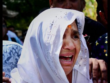 Relative of an accused of Gulbarg society case, crying during pronouncement of verdict at a court in Ahmedabad on Monday. PTI