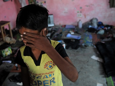 File photo a bonded child labourer crying during a raid and rescue operation conducted by the Bachpan Bachao Andolan (Save the Childhood Movement) in New Delhi. AFP