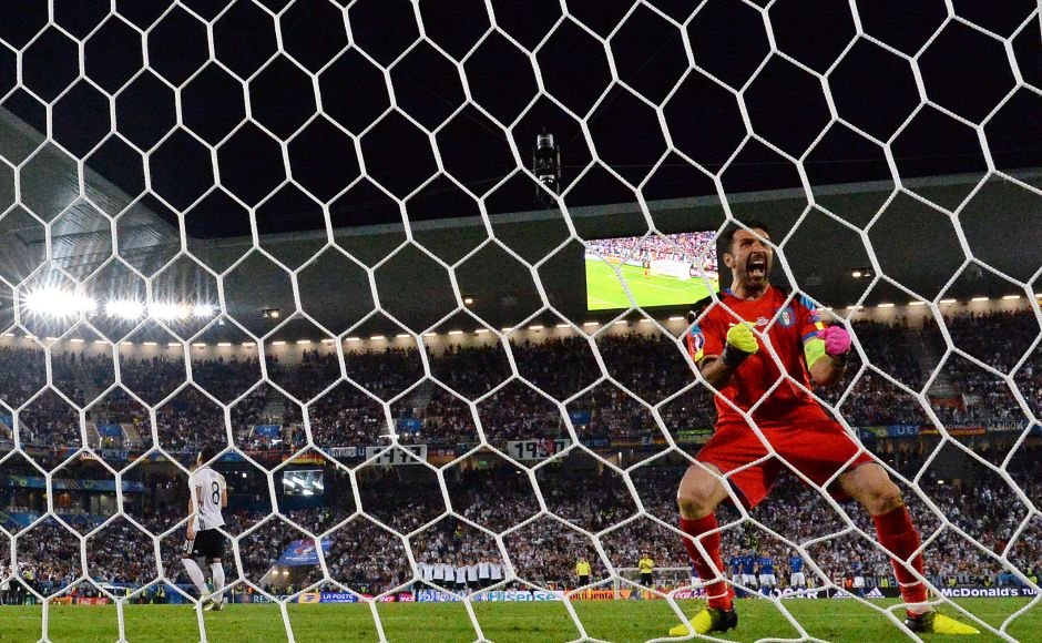 Italy's goalkeeper Gianluigi Buffon reacts after Germany's midfielder Mesut Oezil misses a goal during a spot-kick in the penalty shoot-out in the Euro 2016 quarter-final football match between Germany and Italy at the Matmut Atlantique stadium in Bordeaux on July 2, 2016. / AFP PHOTO / NICOLAS TUCAT