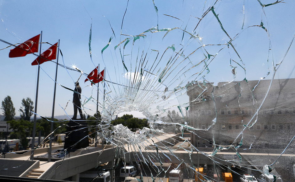 A damaged window is pictured at the police headquarters in Ankara, Turkey, July 18, 2016. (REUTERS/Osman Orsal)