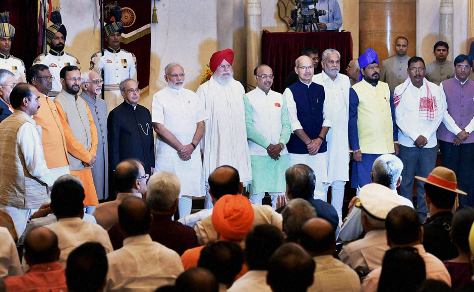 Vice President Hamdi Ansari, President Pranab Mukherjee and PM Narendra Modi with the newly sworn-in ministers. A total of 19 new MPs were sworn-in as junior ministers while Prakash Javadekar was promoted to the Cabinet rank at the swearing-in ceremony at Rashtrapati Bhavan in New Delhi on Tuesday. PTI