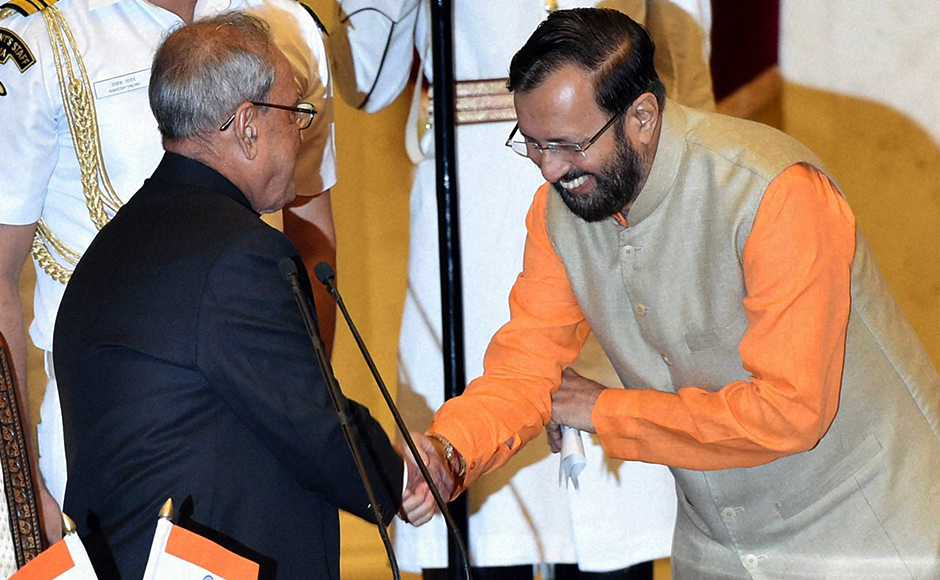 President Pranab Mukherjee greets Prakash Javadekar after administering oath to him as a Cabinet minister during a swearing-in ceremony at Rashtrapati Bhavan in New Delhi on Tuesday. PTI Photo by Shahbaz Khan.