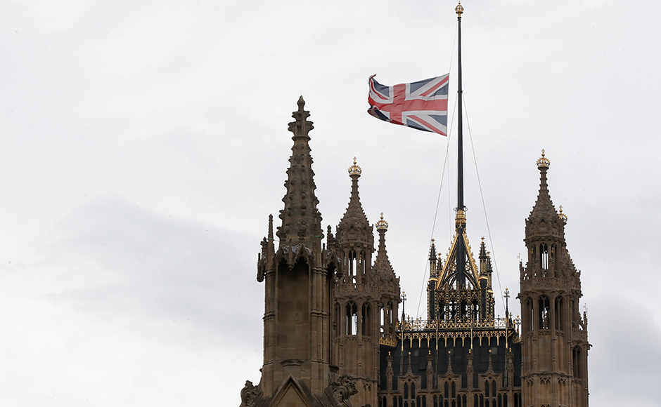 A Union flag flies at half-mast in memory of the Bastille Day truck attack in Nice, at the Houses of Parliament in London, Britain July 15, 2016. (REUTERS/Paul Hackett)