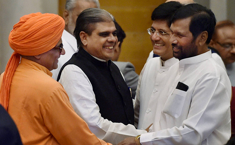 Union Power and Coal Minister Piyush Goyal with minister for Food and Public Distribution Ram Vilas Paswan and MoS for Home Affairs Haribhai Parthibhai Chaudhary at the swearing-in ceremony at Rashtrapati Bhavan in New Delhi on Tuesday. PTI