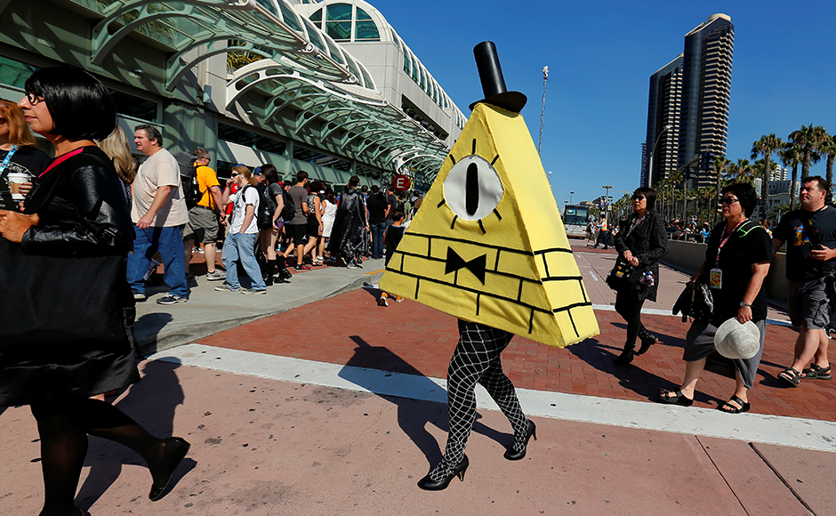A cosplay artist dressed as Bill Cipher arrives for the opening day of Comic-Con. Reuters