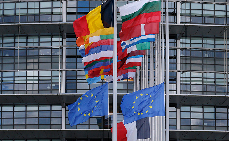 The French and European flags fly at half-mast among flags of the other member states of the European Union in front of the European Parliament in Strasbourg, France, in tribute to the victims of Nice Bastille Day truck attack, July 15, 2016. (REUTERS/Christian Hartmann)