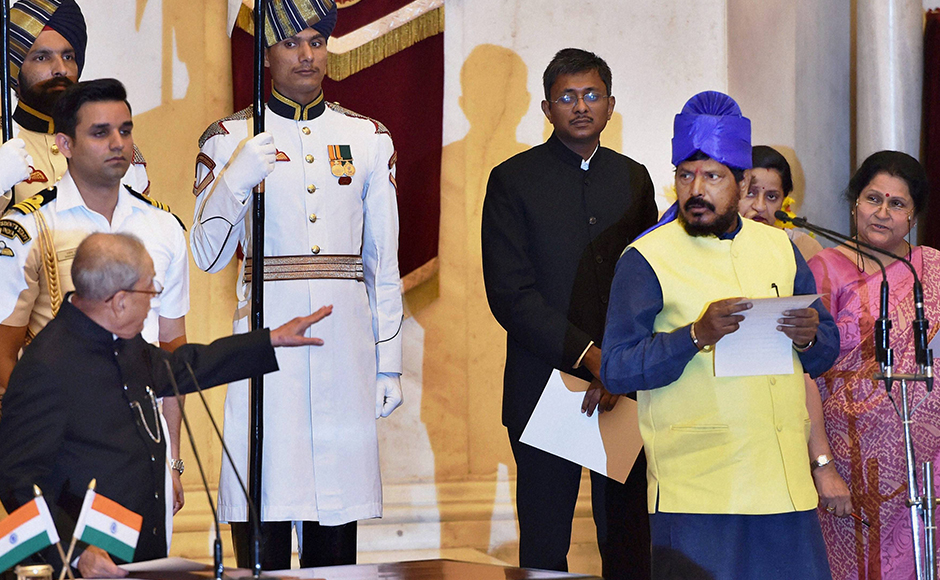 President Pranab Mukherjee administers oath to Ramdas Athawale as Minister of State at the swearing-in ceremony at Rashtrapati Bhavan in New Delhi on Tuesday. PTI Photo by Shahbaz Khan.