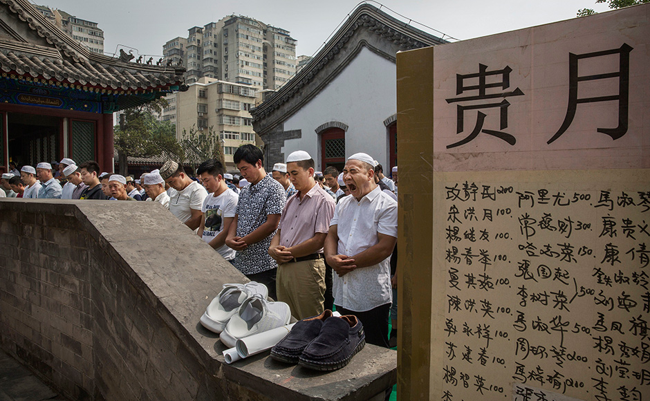 CHINA - JULY 06: A Chinese Hui Muslim man yawns as he and others gather for Eid al-Fitr prayers marking the end of the holy fasting month of Ramadan at the historic Niujie Mosque on July 6, 2016 in Beijing, China. Islam in China dates back to the 10th century as the legacy of Arab traders who ventured from the Middle East along the ancient Silk Road. Of an estimated 23 million Muslims in China, roughly half are Hui, who are ethnically Chinese and speak Mandarin. China's constitution provides for Islam as one of five 'approved' religions in the officially atheist country though the government enforces severe limits. Worship is permitted only at state-sanctioned mosques and proselytizing in public is illegal. The Hui, one of 55 ethnic minorities in China (along with the Han majority), have long nurtured a coexistence with the Communist Party and is among the minority groups with political representation at various levels of government. The Hui Muslim population fast from dawn until dusk during Ramadan and it is believed there are more than 20 million members of the community in the country. (Photo by Kevin Frayer/Getty Images)