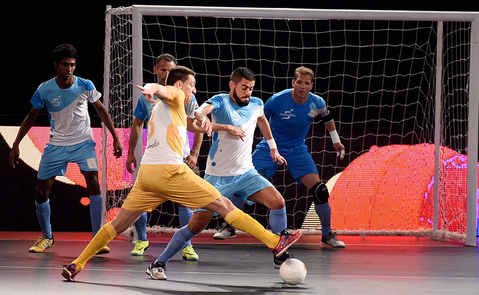 Mumbai 5's and Chennai 5's (yellow) players in action during their match at Premier Futsal Football League, at Nehru Indoor Stadium in Chennai on Friday. PTI Photo by R Senthil Kumar (PTI7_15_2016_000354B)