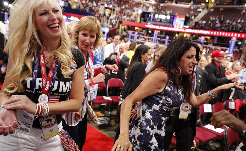 Female delegates dance during the third session. (REUTERS/Jonathan Ernst)