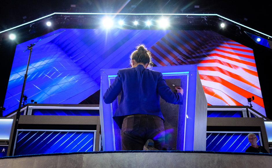 Final touches are made to the podium Sunday evening, July 24, 2016, as the Democratic National Convention prepares to kickoff on Monday in Philidelphia. (AP Photo/J. David Ake)