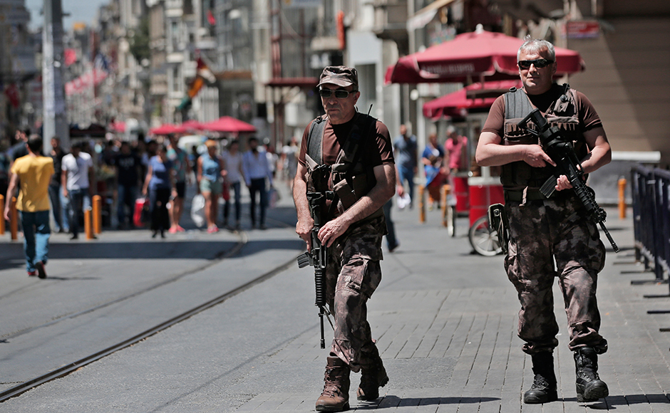 Turkish police special forces officers patrol outside the French consulate in central Istanbul's Istiklal Avenue, the main shopping road of Istanbul, Friday, July 15, 2016. Security forces continue to patrol the area around the French consulate in Istanbul Friday a day after an attack in the French resort town of Nice. (AP Photo/Lefteris Pitarakis)