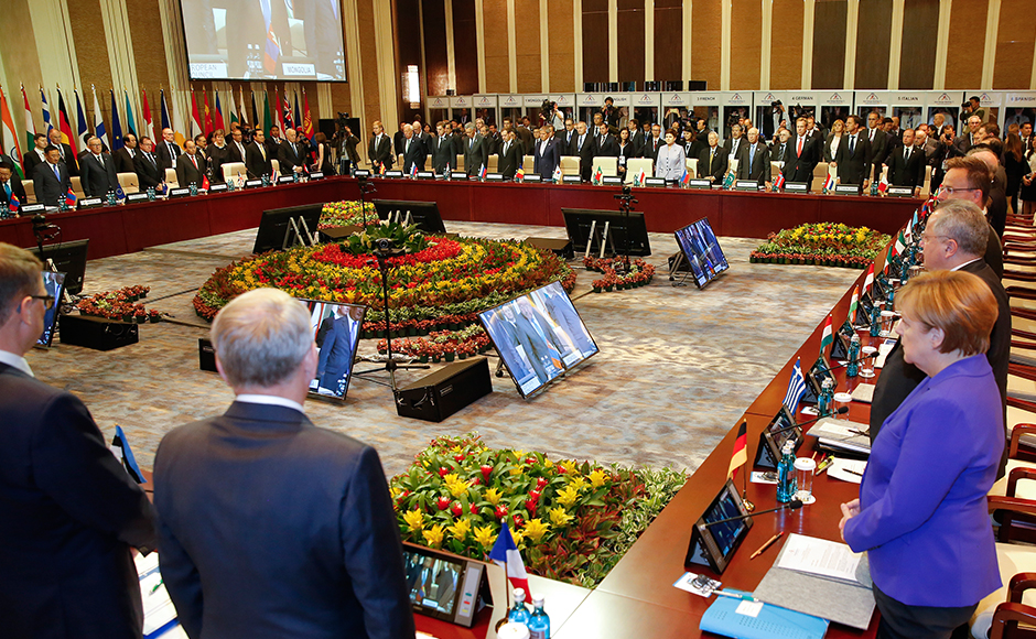 Leaders stand for a minute of silence for the victims of a deadly attack in the French city of Nice, before the opening session of the Asia-Europe Meeting (ASEM) summit in Ulaanbaatar, Mongolia, Friday, July 15, 2016. (Damir Sagolj/Pool Photo via AP)