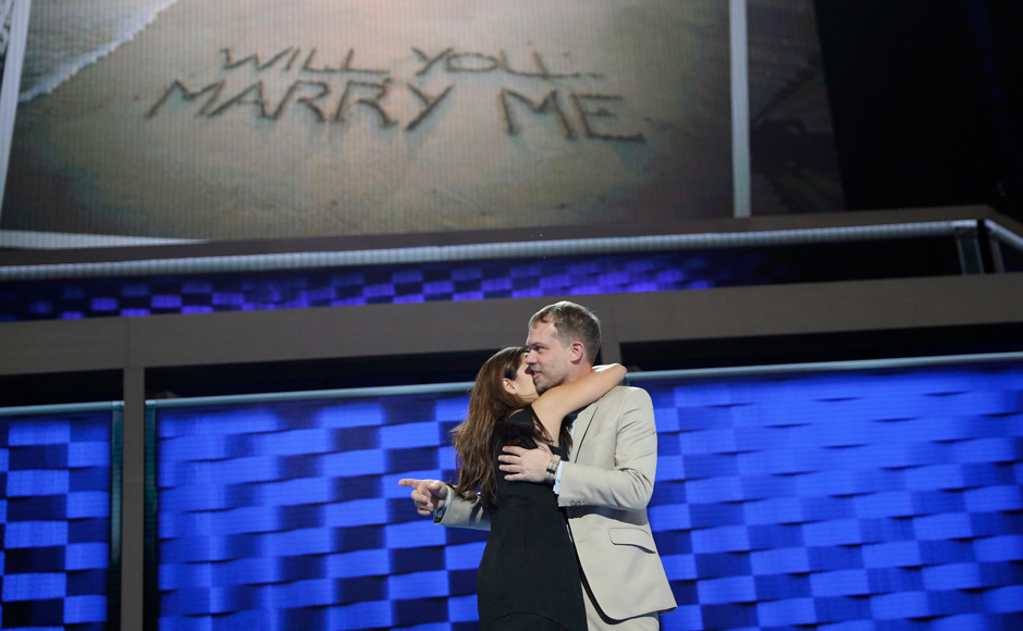 Andrew Binns, right, embraces Liz Hart after the two got engaged on the main stage before the 2016 Democratic Convention, Sunday, July 24, 2016, in Philadelphia. The two work on production for the convention. (AP Photo/John Locher)