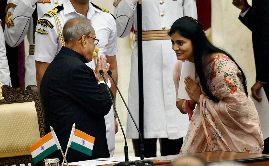 President Pranab Mukherjee greets Anupriya Patel after she was sworn-in as Minister of State at a ceremony at Rashtrapati Bhavan in New Delhi on Tuesday. PTI Photo by Shahbaz Khan