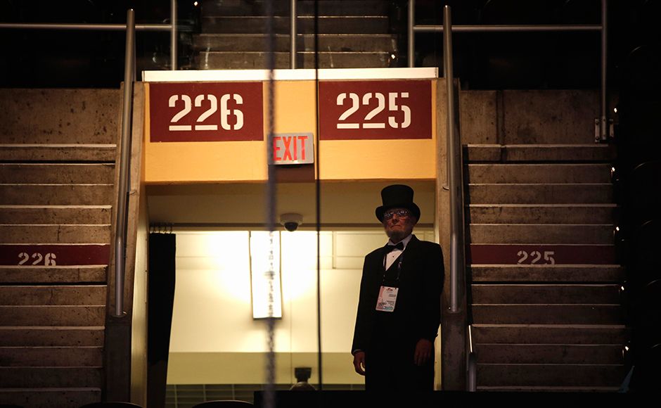 A delegate dressed as former Abraham Lincoln looks on during the third day. (REUTERS/Mike Segar)
